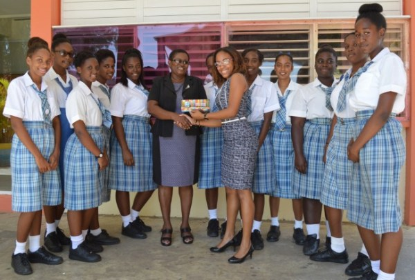 BT Account Executive Tamesha Doughty presenting Springer Memorial principal Pauline Benjamin with tickets to third Test West Indies vs England match.