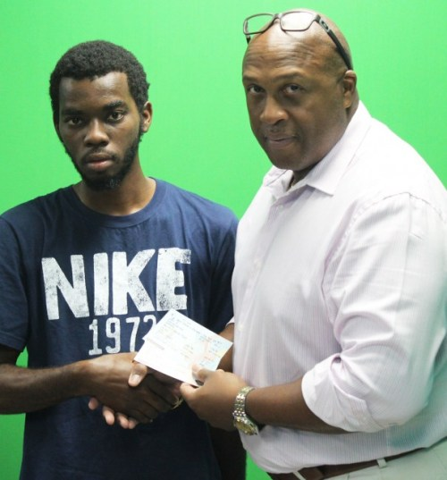 BT Marketing Manager David Williams presenting Trimaine Walker with his prize.
