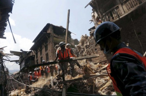 Nepalese army personnel clear the debris of a collapsed house as they carry out rescue operations in Bhaktapur.