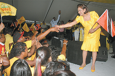 Prime Minister Kamla Persad-Bissessar greeting supporters at yesterday's 26th anniversary  celebration of the party at Rienzi Complex, Couva.