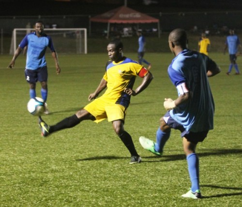 Renaldo Gilkes (right) of Notre Dame tried to make a pass while UWI goal scorer Trey Hart (centre) attempted an interception.