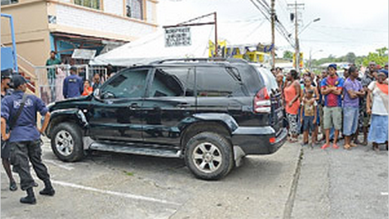 A heavily tinted vehicle pulling into the Sangre Grande Magistrates' Court area yesterday morning with several of the 12 police officers charged with misbehaviour in public office following a hot water incident in which an accused was burned.