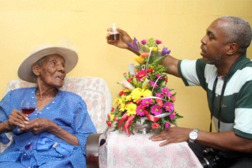 Nephew Vernon Smith making a toast to Aunt Berths Wells on her 100th birthday today.
