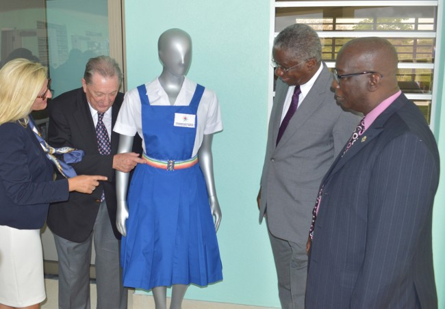 Director of the Derrick Smith School And Vocational Centre, Phillipa Challis, and benefactor Derrick Smith showing off a sample of the children's uniform to Prime Minister  Freundel Stuart and Minister of Education Ronald Jones.