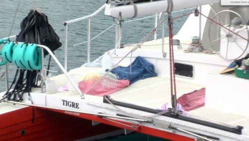 The elderly man's body on board the catamaran.