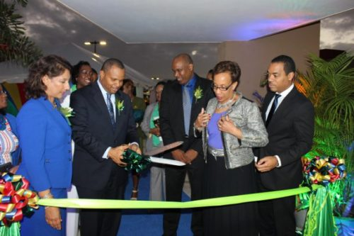 Minister of Finance Chris Sinckler (third from left) cutting the ribbon as First Citizens Bank officials (from left) Karen Dabarsie, Deborah Jones-Wilson (partly hidden), Glyne Harrison, Sharon Christopher and Jason Julian look on.