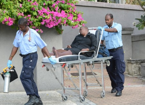 An acquaintance of Constable Everton Gittens fainted at the court hearing.