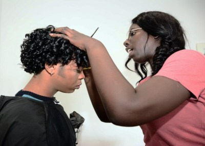 Make-up artist Helene Headley transforming actor Du-Wayne Hinds into National Hero Samuel Jackman Prescod.