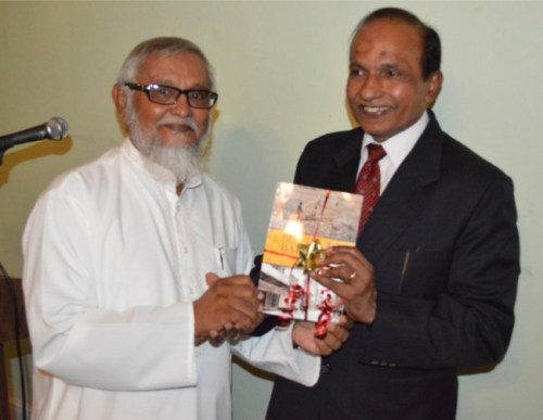 Bengal To Barbados author Sabir Nakhuda (left) presenting Permanent Secretary in the Ministry of External Affairs, New Delhi, Swaminathan Ramachandran, with a copy of his book.