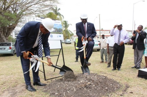 Minister of Health John Boyce (left) and US Ambassador to Barbados and the Eastern Caribbean Dr Larry Palmer breaking ground for the construction of the new reference lab.