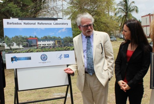 Architect Lou Krupnick of Page Southerland (left) shows director of the CDC Caribbean Regional Office, Dr Rachel Albalak, what the new reference lab will look like.