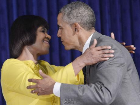 President Barack Obama embraces Jamaica's Prime Minister Portia Simpson Miller following their bilateral meeting.
