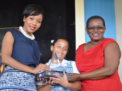 From left, SOL group marketing and communications coordinator Gina Cummins, Best Overall Student Keziah Taylor and principal Pauline Benjamin.