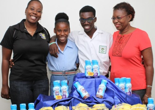Darryl Jordan physical education teacher  Shakera Shorey, athletes Mary Fraser  and Rivaldo Leacock and Athletic Association  manager Maureen Dottin were happy with their gifts.