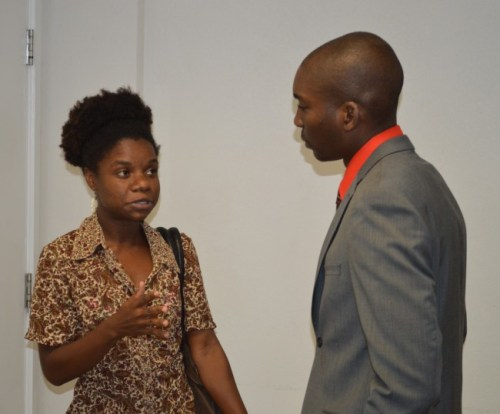 University of the West Indies student Carla Daniel (left) speaking with David Bynoe, national coordinator of GEF Small Grants Programme-Barbados.