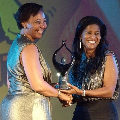 Minister of Labour Dr Esther Byer (right) presenting the Large Business Most Valuable Improver Award to Laina Jacob.