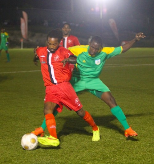 Brittons Hill top striker Dwayne Stanford dribbling his way around BDFSP's Kyle Gibson.