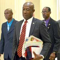 Opposition Leader Dr Keith Rowley leaves the Parliament Chamber yesterday following a walk out by members of the Opposition benches.