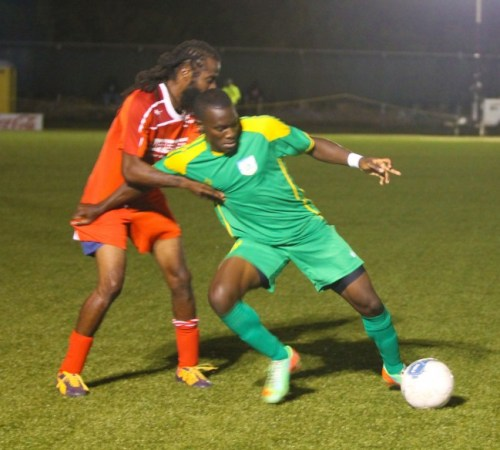 Rashad Jules of BDFSP (right)had a good night for his team with two goals.