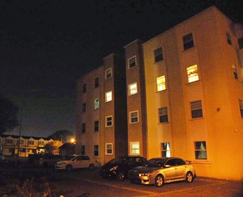 The compound of Country Park Towers in Country Road, St Michael, thrown into darkness at nightfall.