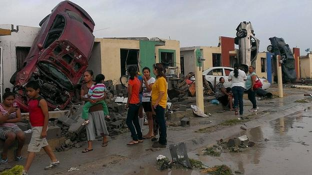The tornado lifted cars onto houses