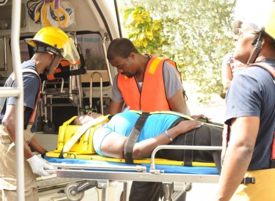 This passenger had to be placed on a stretcher before being lifted into an ambulance.