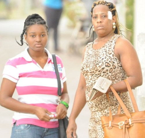 Cherral Springer (right) leaving her apartment with a relative following Monday's incident.