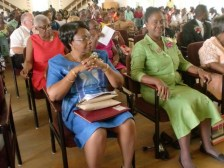 Sharon Primary Principal Pamela Small-Williams (right at front) sitting next to guest speaker Delores Thompson at the school's  2015 graduation.