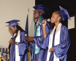 From left, headgirl Keshanna Leacock, Jherrad Morris-Sealy and Sidnee Alleyne performing a song.