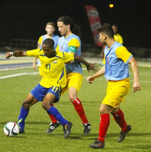 Goal-scorer Hadan Holligan being put to the test during last night's game against Aruba.