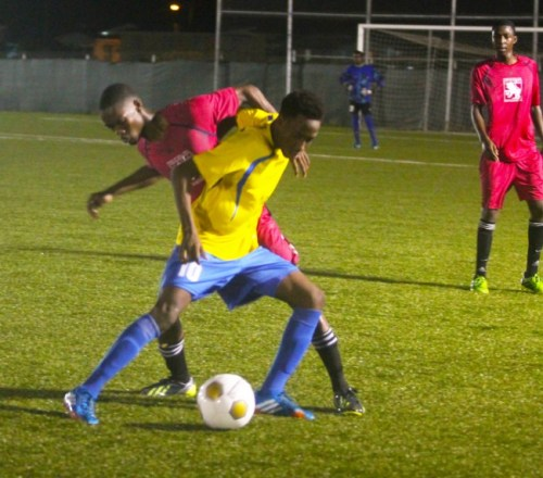 Omani Leacock of Notre Dame and Nicholas Jones of Pride of Gall Hill battle for ball possession.