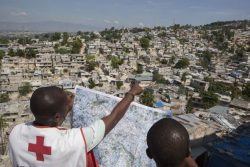 On November 15, 2012, two Red Cross officials review a map of Campeche, a neighbourhood targeted by the American Red Cross for a community regeneration project.