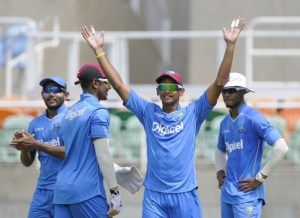 Shane Dowrich (hands raised) at practice today along with Devendra Bishoo (left), captain Denesh Ramdin (second left) and Shai Hope.