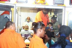 Survivors of the plane  crash in an ambulance receiving medical attention.