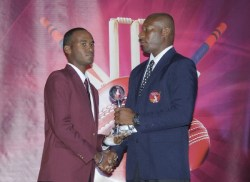 Test batsman of the year Kraigg Brathwaite (left)receives his award from Nixon McLean.