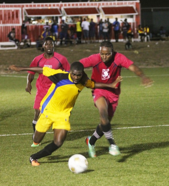 UWI's Amal Mayers (left) and Gall Hill goal-scorer Rico Graham battle for the ball.