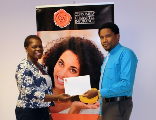 The winner of CGI's 'Win Free Insurance Promotion' Veronica Powell receiving her prize of free home insurance for a year from Dwayne Holder, CGI's Operations/Underwriting Manager.