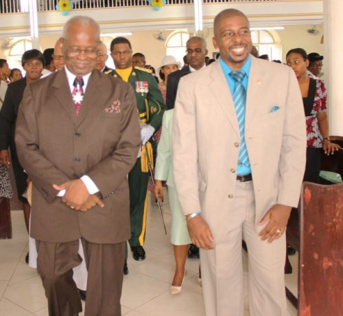Governor General Sir Elliott Belgrave (left) and Reverend Adrian Smith (right) of the Calvary Moravian lead the procession at yesterday's Father's Day service.