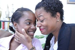 Kayla Tull could not hold back the tears as she congratulated her daughter top student Jasmine Simmons.