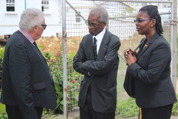 From left, Alair Shepherd QC in conversation with fellow attorney Ezra Alleyne and Nation Publisher Vivian-Anne Gittens outside the courtroom today.