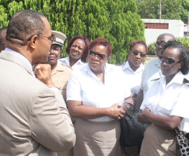 Minister of Finance Chris Sinckler (left) following recent talks with Customs workers and their unions.