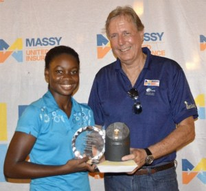 Allyssa Inniss-Gittens, 14, winner of women's 1st flight, receives her prize from Michael Armstrong.