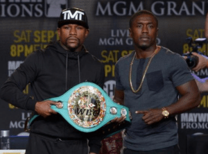 Andre Berto (right) and Floyd Mayweather Jr.