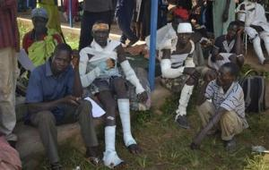 Burn victims waiting to be evacuated to the capital Juba by plane for medical treatment at the hospital in Maridi, Western Equatoria State, South Sudan, today.