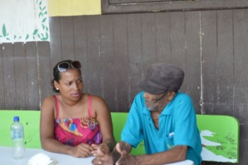 Adena Antoine speaking with another Petite Savanne resident.