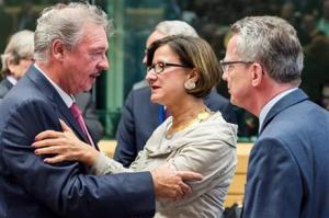 German Interior Minister Thomas de Maiziere, right, talks with Luxembourg's Minister of Foreign and European Affairs Jean Asselborn, left, and Austrian Interior Minister Johanna Mikl-Leitner at the start of a meeting of EU justice and interior ministers at the EU Council building in Brussels today.