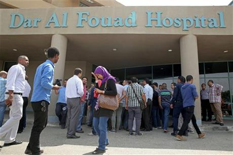 Egyptian journalists waiting for information about tourists who were injured Sunday while on a desert safari trip, in front of the Dar Al Fouad Hospital in Cairo, Egypt, today.
