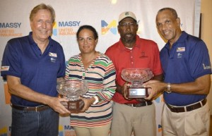 Golf champions Carlsen Leacock (second right) and Leiza Munn-Blakeley receiving trophies from Massy United Insurance's Michael Armstrong (left) and BGA president Cally Boyea (right).