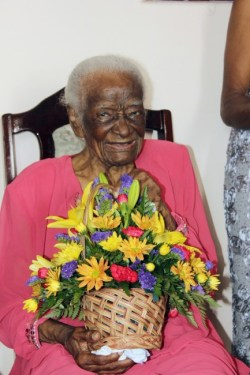 There was much laughter in the atmosphere when Governor General Sir Elliott Belgrave visited centenarian Viola Als at her Jericho, St George home this morning.