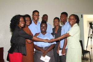 The students being congratulated by form teacher Kathy-Ann St Hill-St Lawrence (left), Education Officer Montege Deane-Bowen (second from left), Education Officer Janice Gibbs (third from left)  and Ann Hill's principal Emelda Belle (right).
